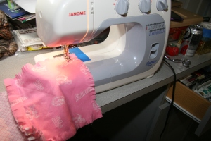 Sew blocks together with 1-inch seams, fringe on the right side