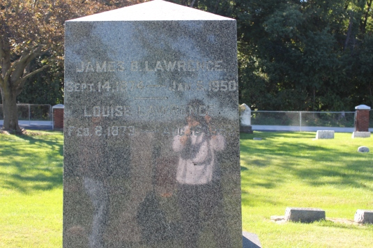 my brother and I reflected in our ancestors' grave marker
