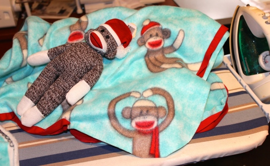 sock monkey and fleece blanket